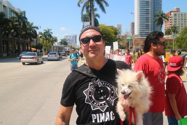 The founder of PINAC with his dog. ©Carlos Miller.