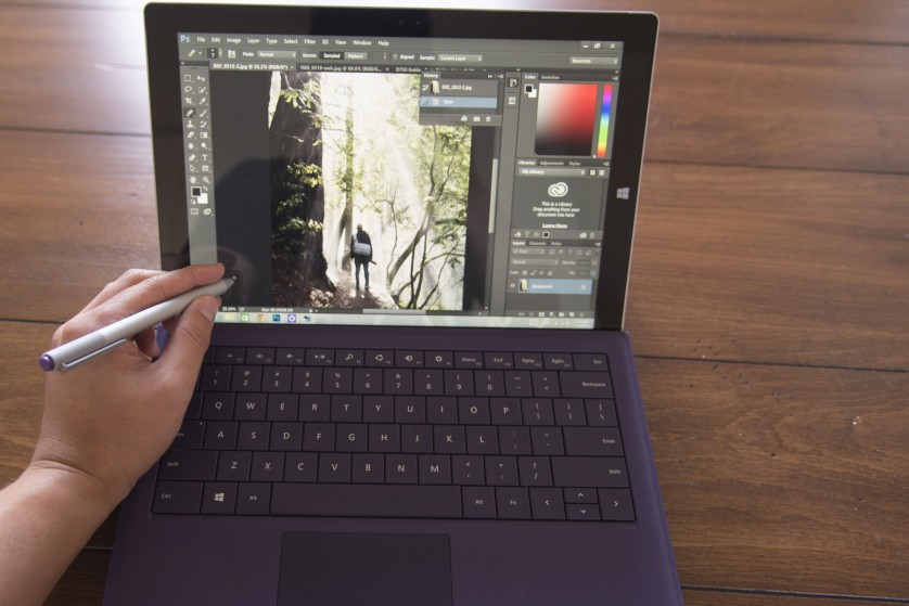 This is an incredibly unnatural way to use a pen, but luckily Photoshop doesn't actually require the keyboard be attached.