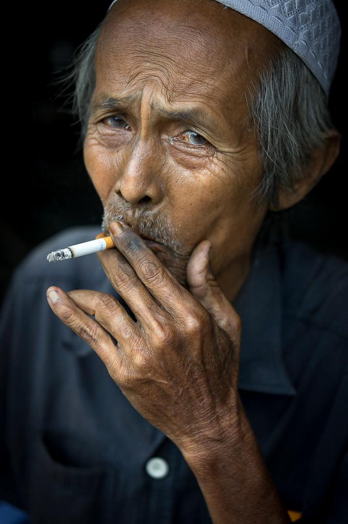 12. Cham old man smoking in An Giang, Vietnam
