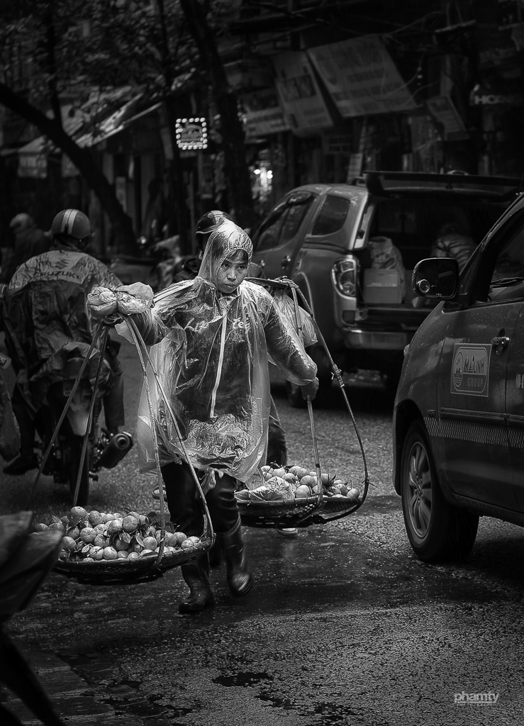 14. Cold winter in Hanoi woman with baskets