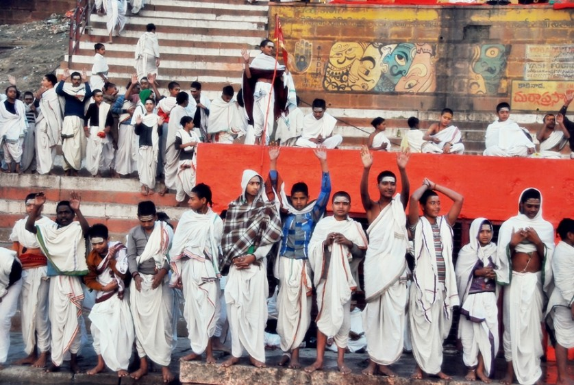 Young boys partaking in a morning ceremony along the Ghats in the Ganges River © Nomadic Experiences