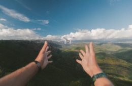 drone, aerial, hands, mountains, sky