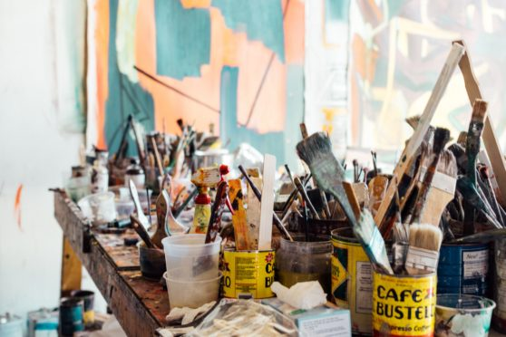 paintbrushes, supplies, clutter