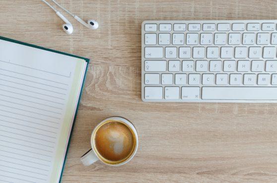 keyboard, coffee, earbuds, journal