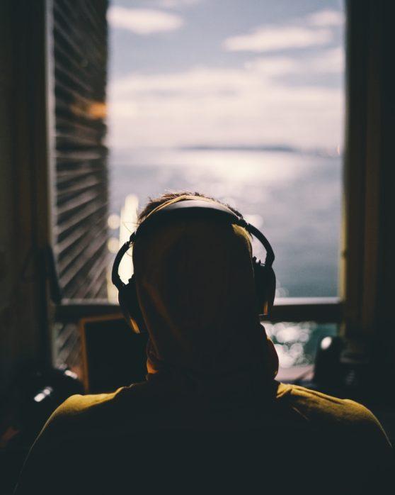 person, headphones, window