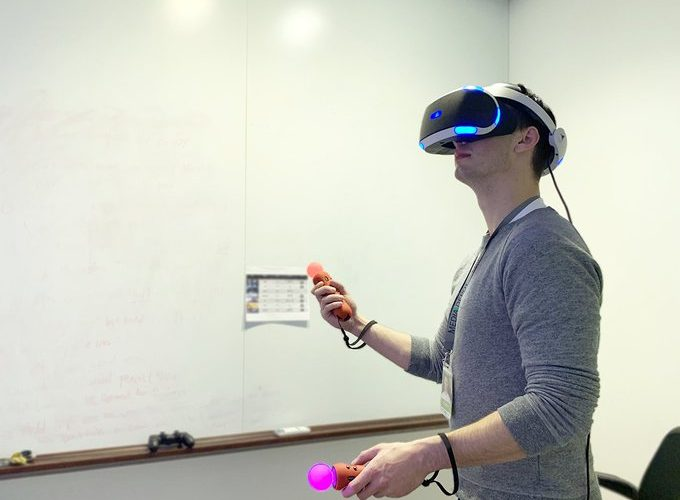 A college student enjoying PlayStation VR