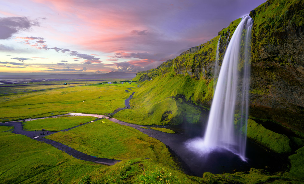 waterfall against green landscape